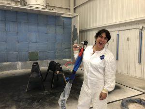 A woman holding a spray gun